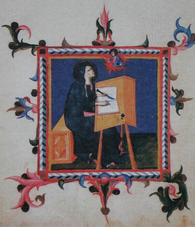 A nun working on a manuscript.