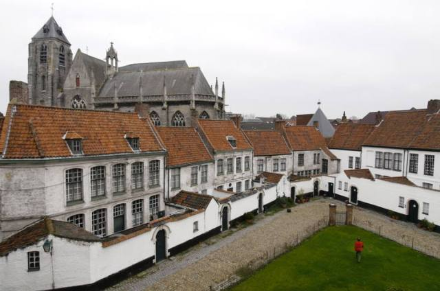 a beguinage, an architectural complex to house Beguines